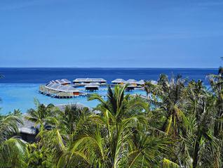 Velaa Private Island mit Blick auf Wasserbungalows